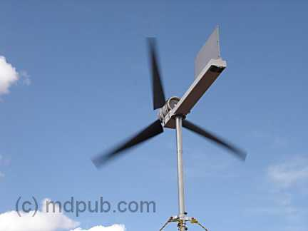 The wind turbine spinning in the wind