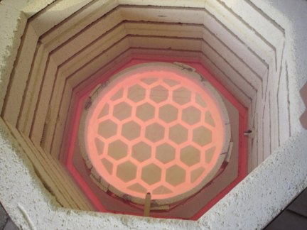 The 12.5 in hexagonal-back, honeycomb mirror in the kiln.