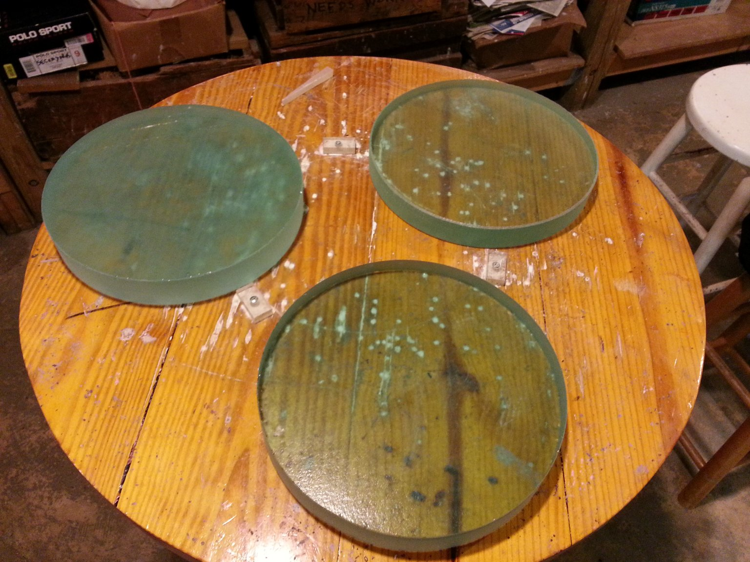 Three fused glass telescope mirror blanks.